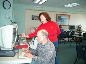 Caroline Helping a Lab Student